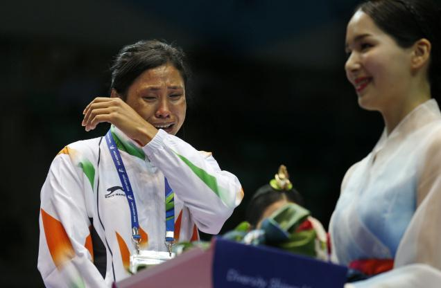 Sarita Devi, coaches and chef-de-mission suspended
