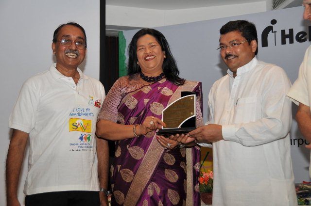 "Excellence Award 2011"" to Madam Grace Pinto"