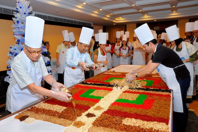 Cake mixing ushers in Christmas season in Manipal