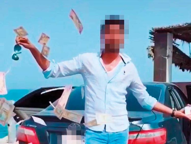 Man throws money to show off in Dubai, lands in police custody