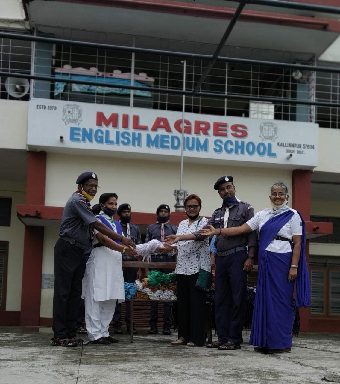 The Scouts and Guides of Milagres Eng. Med. School hands over 2020 masks to local association