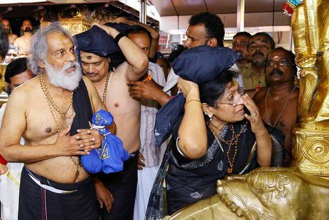 Yesudas prays with wife at Sabarimala