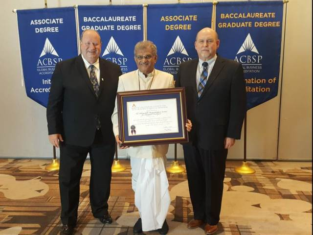 Dr.Veerendra Heggade received SDMIMD's International Accreditation at Anaheim, USA