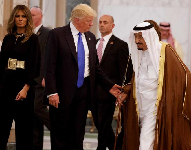 Saudis welcome Trump with gold medal, receive arms package