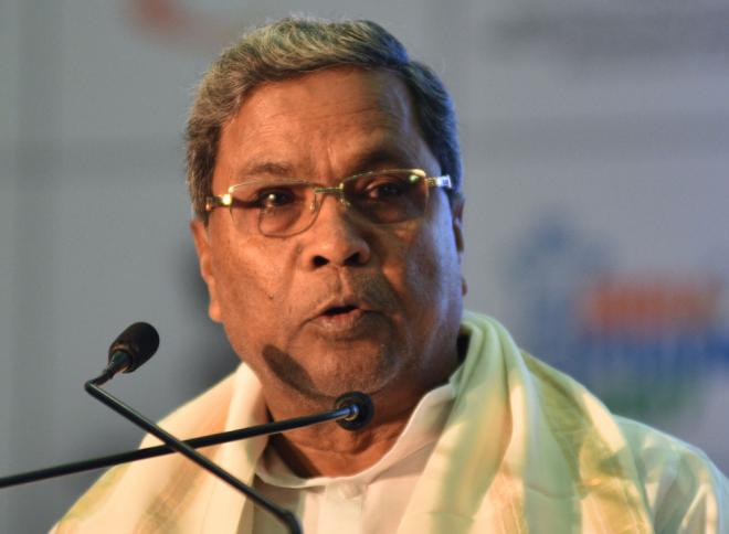 Shiv Sena dares Sonia to sack Siddaramaiah on flag issue