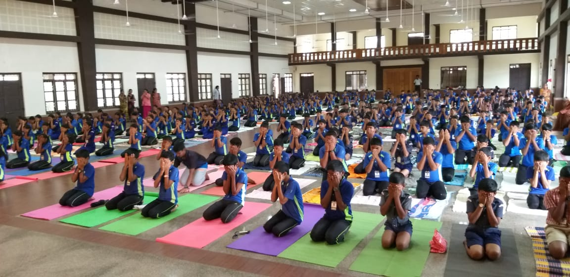 """Yoga deals with energy within us and innature"" - P V Bhatat Milagres English Medium School International Yoga Day Celebration"