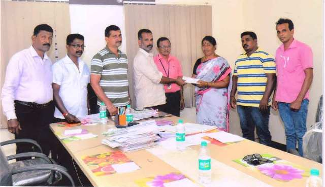 Kemmannu: Ganapathi Co-operative hands over Insurance amount of Rs. 1 Lakh to deceased member's family.