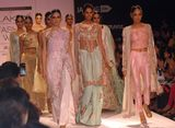 Models display the Designers Outhouse collection during the lakme Fashion Week 2014