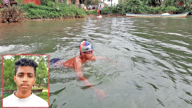 Boy creates record by swimming 24 Km with legs bound in chains