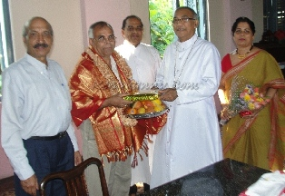 Bishop of Mangalore felicitated the retired Airport Director