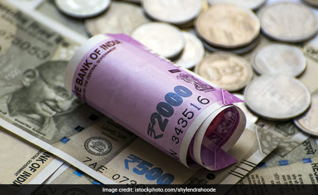 Rupee plunges to record low of 71 against US dollar