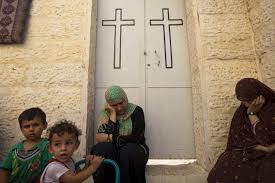 Muslims pray in Gaza church as bombs fall ahead of Eid