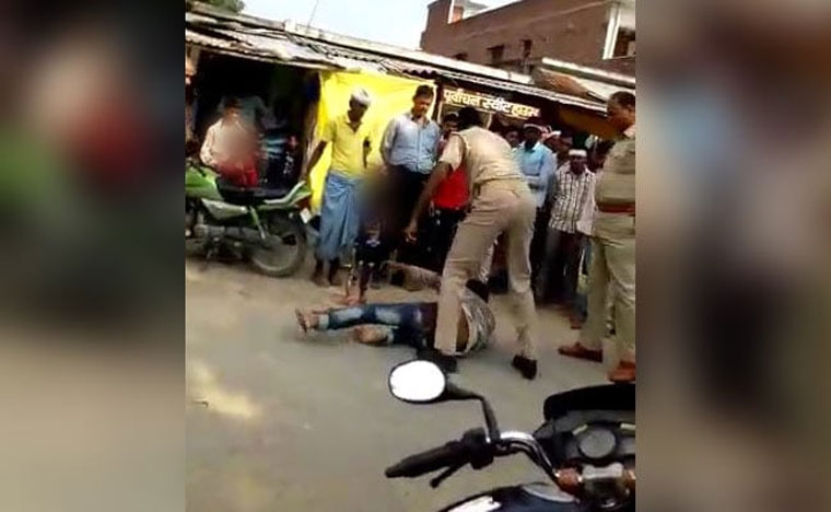 2 UP cops thrash biker in public as child looks on; suspended