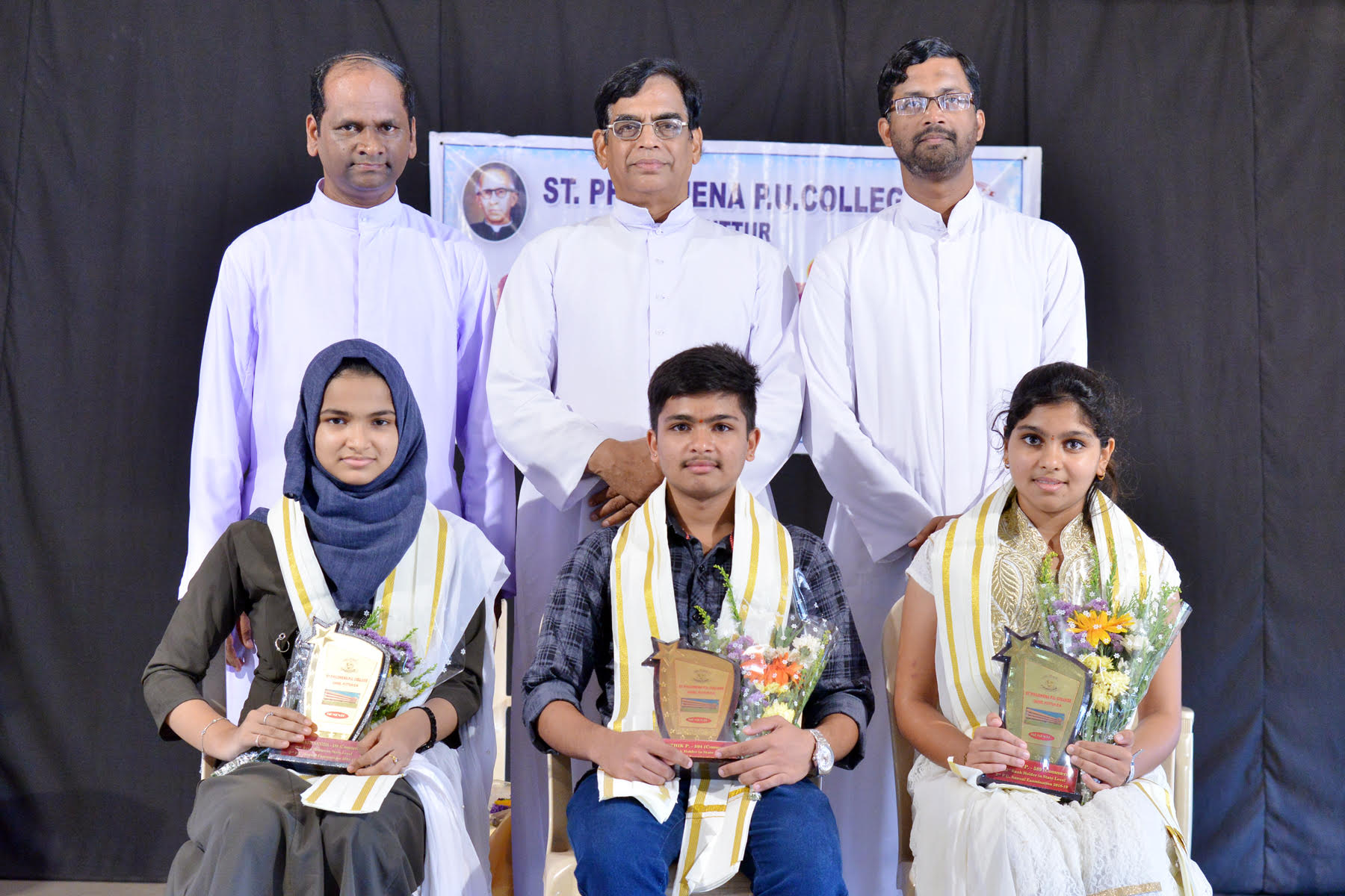 Felicitatiion to Dintinction holders at St. Philomena College, Puttur