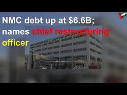 NMC debt up at $6.6B; names chief restructuring officer