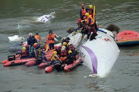 Taiwan plane cartwheels into river after take-off, killing at least 19