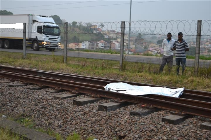 Man walking along tracks, crushed by oncoming train